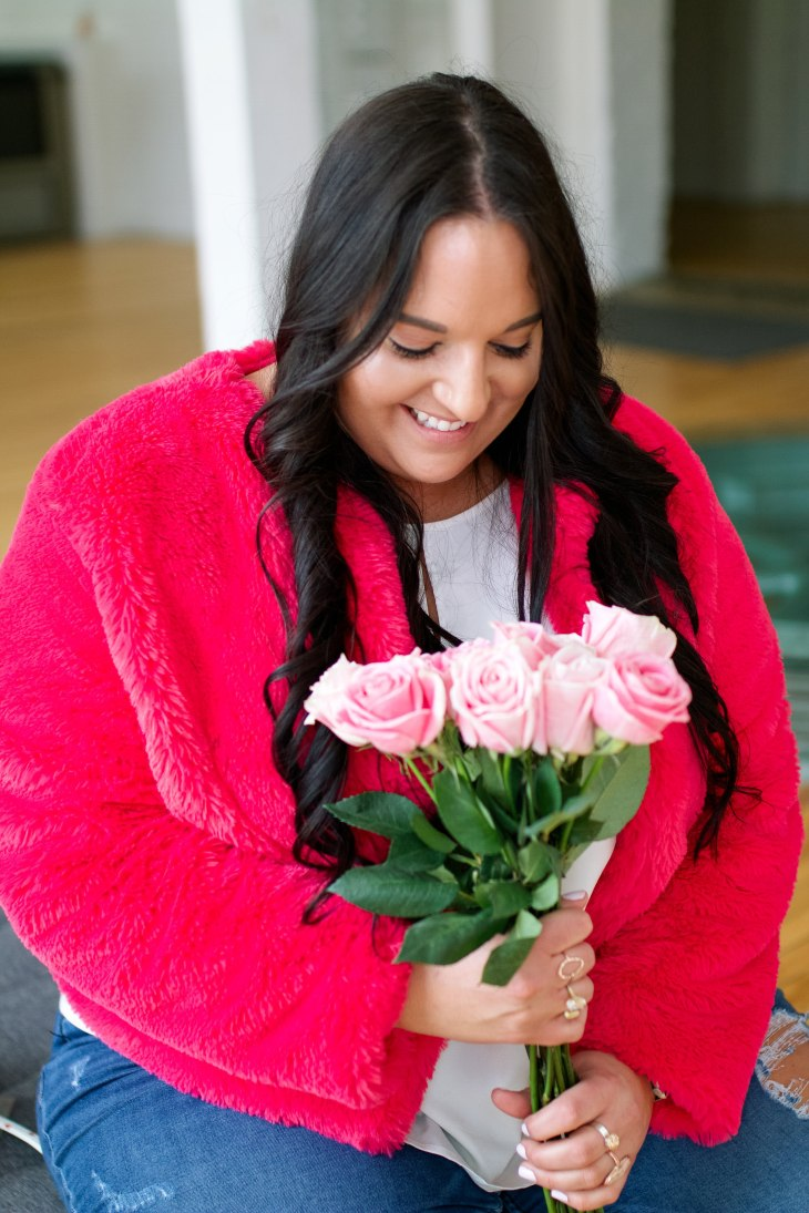 Valentine's day look with roses, faux fur pink coat